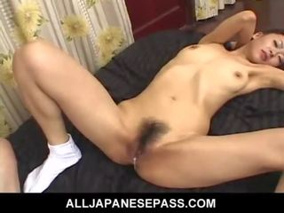 Oversexed seductress in a kimono has her pussy fingered and fucked